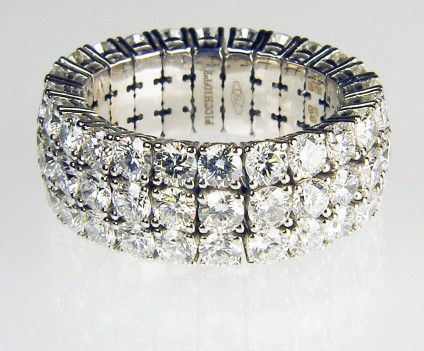 Expanding range triple row of diamond full set eternity ring - Picchiotti designed and manufactured expanding full set eternity ring with 5.03ct of G colour VS clarity round brilliant cut diamonds, each diamond 3mm in diameter. The ring is made with the diamonds mounted in jointed links connected to a superbly crafted highly durable titanium spring. The ring can expand up to 5 ring sizes to allow comfortable and secure wear even on fingers with large knuckles or where the wearer routinely experiences changes in finger size. 18ct white gold.   Ring is manufactured to order only and can be made with any combination of gemstones to the customer's requirements.