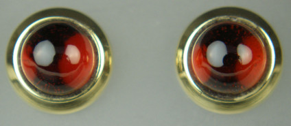 Round garnet cabochon earstuds in 9ct yellow gold - 2.25ct pair of round cabochon red garnets rubover set in 9ct yellow gold earstuds. Earstuds are 8.8mm in diameter
