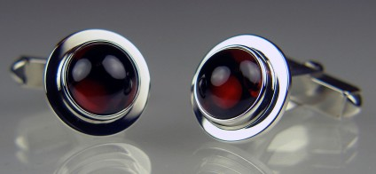 Rhodolite garnet cufflinks in silver - 11.11ct pair of round cabochon rhodolite garnets mounted in silver