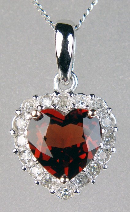 "Lovely garnet heart cut pendant with diamond halo in 9ct white gold - Lovely red garnet heart cut surrounded by round brilliant cut diamonds in 9ct white gold and suspended from an 18"" 9ct white gold chain"