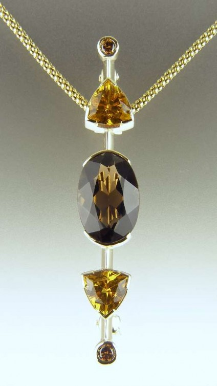 Smoky quartz, golden beryl & cinnamon diamond pendant - Oval smoky quartz (customer's own) set with 2.18ct golden beryl trillion cuts and a matched pair of cinnamon diamonds.  Mounted as a pendant - convertable to a brooch - in 9ct yellow gold.