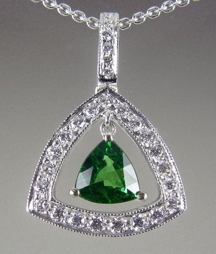 Tsavorite & diamond pendant - Tsavorite green garnet & diamond earrings. 0.87ct tsavorite trillion set with 0.35ct diamonds in 18ct white gold. 22x16mm.