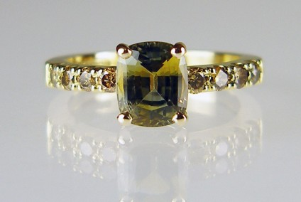 Sapphire & yellow diamond ring - 2.07ct bicolour cushion cut sapphire mounted in 18ct yellow gold and flanked by 0.39ct of natural golden yellow diamonds
