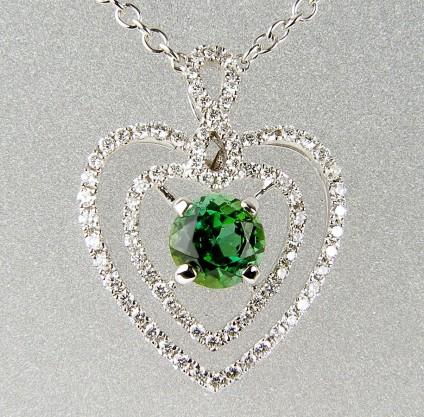 Green tourmaline & diamond pendant - Green tourmaline heart pendant -Heart shaped necklace in 18ct white gold set with 0.78ct round green tourmaline and 0.33ct white diamonds.