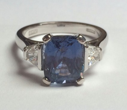 Grey-blue Sapphire & Diamond Ring - 4.28ct rectangular cushion cut grey-blue sapphire set with a pair of 0.48ct F-G colour VS2 clarity diamonds set in 18ct white gold