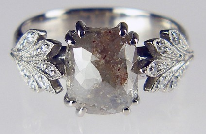Rose cut diamond ring in palladium - 2.25ct rose cut grey diamond set with 10 x 1.2mm round brilliant cut white diamonds in palladium. Beautiful silver grey diamond shimmers subtly and is flanked by a pair of delicate millegrain edged leaves.  The shank has a lightly roughened texture to resemble bark.
