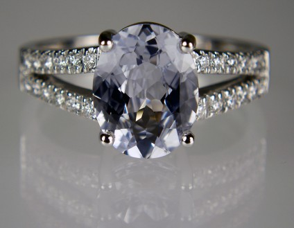 Ice sapphire & diamond ring - 2.76ct oval mixed cut ice sapphire set with 24 x 1.3mm round brilliant cut diamonds in F colour VS clarity (0.24ct) mounted in 18ct white gold ring.