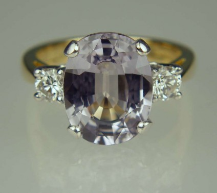 Grey sapphire & diamond ring - 4.90ct oval cut grey sapphire set with 0.30ct diamonds in 18ct yellow gold and platinum