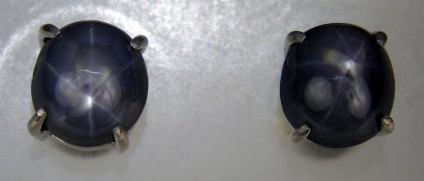 Grey star sapphire cabochon earstuds  - Unusual grey star sapphire cabochon pair weighing 4.92ct set as earstuds in rhodium plated silver.  The star sapphires are from Myanmar.