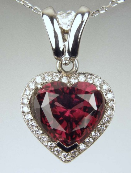 Red tourmaline & diamond pendant - 4.25ct heart cut red tourmaline set with 0.3ct of round and heart cut diamonds, mounted in 18ct white gold. The pendant is 23mm long and 14mm wide.