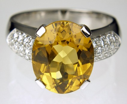Golden beryl & diamond ring - Golden Beryl & Diamond Ring. Ring of 4.17ct oval golden beryl set with 0.35ct diamonds in 18 carat white gold. Central stone 10 x 12mm.
