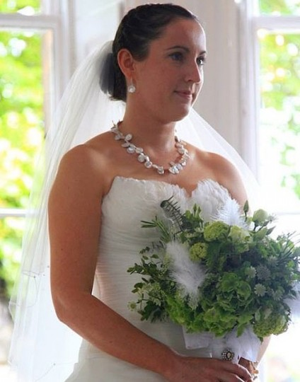 Jade on her wedding day wearing her Just Gems designed pearl necklace - Beautiful keishi cultured pearls mounted with a silver clasp give a dramatic and lustrous glow to the beautiful bride on her wedding day.  Just Gems has a wide range of similar pearls in stock and can create a piece specially to complement your wedding dress, make-up and hair