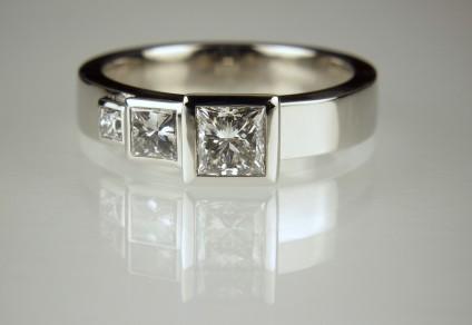 Princess cut diamond ring - 1/2ct diamond with 20pt & 5pt diamonds, all princess cut, and bezel set in platinum
