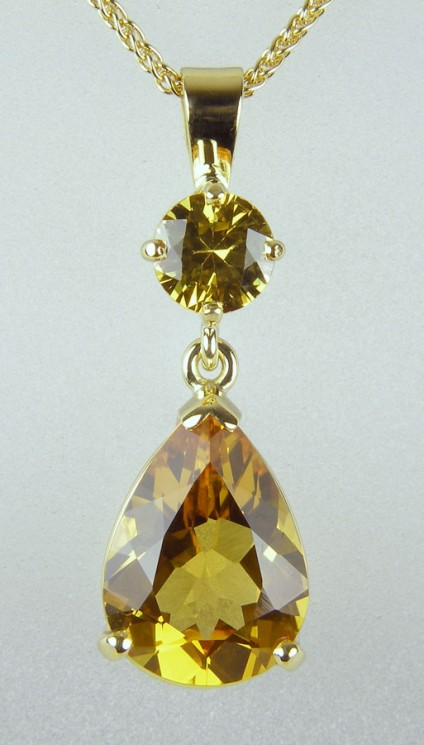 Golden sapphire & beryl pendant in gold - 2.84ct pear cut golden beryl set with round brilliant cut golden sapphire 0.59ct in yellow gold.