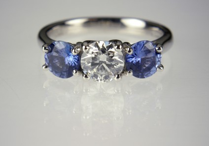 Diamond & sapphire ring in platinum - 70pt diamond round brilliant, GIA certificated in G colour/SI clarity/Excellent cut quality, set with a matched pair of round brilliant cut Sri Llankan sapphires 1.16ct in platinum