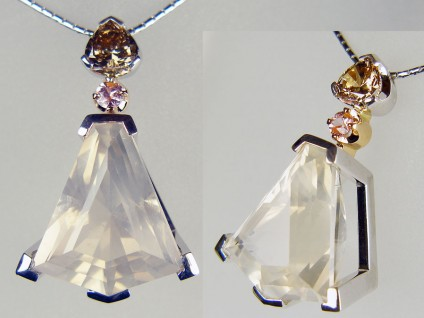 "Kildrummy quartz, brown diamond and pink sapphire pendant in 18ct rose and white gold - 22.65ct Isobel cut (by Ivan Williamson of Hascosay Gems) Kildrummy quartz (natural rock crystal found in the hills near Kildrummy, Aberdeenshire, Scotland), set with 0.21ct round pink sapphire and 1.02ct heart cut natural brown diamond, in a handmade pendant in 18ct white and rose gold, suspended from a 16"" anaconda style chain in 18ct white gold"