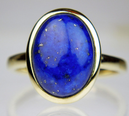 Lapis cabochon oval ring in 9ct yellow gold - Oval cabochon Afghan lapis lazuli rubover set in 9ct yellow gold