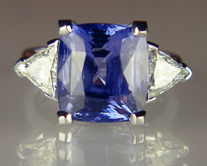 Sapphire & triangular diamond ring in 18ct white gold - 11.47ct cushion cut Sri Lankan sapphire set with a 1.13ct matched pair of triangular diamonds G colour VS1 & SI1 clarity each stone respectively, mounted in 18ct white gold ring