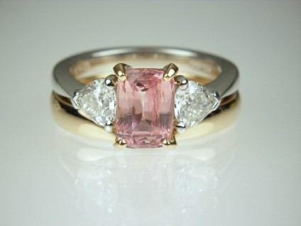 Padparadscha & Diamond Ring - Unheated, natural colour, beautiful Padparadscha pink 2.6ct sapphire mounted with a matched pair of heart shaped white diamonds 0.92ct, E-F colour VS clarity, in 18ct rose and white gold. With a shaped rose gold wedding band.