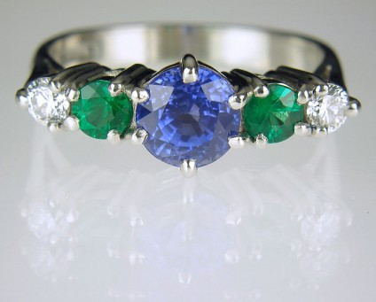 Sapphire, emerald & diamond ring in platinum - Platinum ring set with 1.5ct mid blue Sri Llankan sapphire, a pair of fine quality Colombian emeralds totalling 0.3ct and a pair of E colour VS clarity diamonds totalling 0.2ct