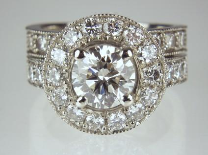 Diamond cluster ring with matched wedding band - 1.22ct round brilliant cut diamond surrounded by diamonds with diamond set shoulders and matching diamond set wedding band all in platinum.