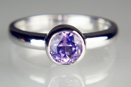 Lilac sapphire ring in 18ct white gold - 5.4mm round 0.96ct lilac sapphire rubover set in 18ct white gold ring