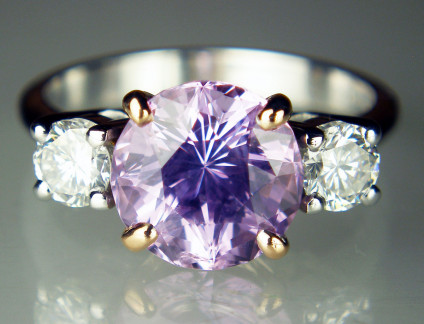 Lilac sapphire ring in 18ct white gold - Spectacular brilliant cut lilac sapphire of 3.61ct flanked by a 0.56ct matched pair of 4.1mm round brilliant cut diamonds of H colour VS clarity. The sapphire is mounted in 18ct rose gold, the diamonds and shank are in 18ct white gold