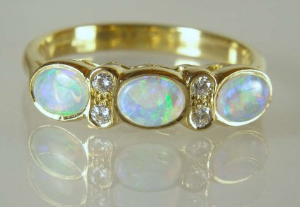 Opal & diamond ring - 0.62ct of pretty white opals with vivid blue/green colour flashes set with 0.09ct white diamonds (G/VS) in 18ct yellow gold