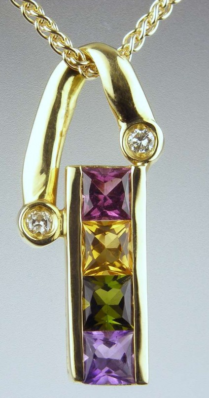 Brazilian gemstone pendant - 1ct of Brazilian gemstones (tourmaline - green and red; amethyst; citrine) set with 2 points of diamonds in 18ct yellow gold with matching chain