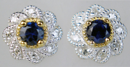 Sapphire & diamond cluster eartsuds in 9ct white & yellow gold - Central dark round brilliant cut sapphirse surrpunded by round brilliant cut white diamonds in 9ct white & yellow gold