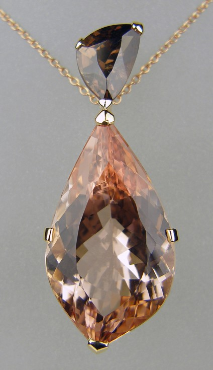 Morganite & colour change garnet pendant in rose gold - Spectacular pendant measuring 43mm long all mounted in 18ct rose gold.  Set with a 22.64ct fantasy cut morganite and a 3.29ct leaf cut colour change garnet (changes from brown in daylight to reddish brown in artificial light). Suspended from a rose gold chain.