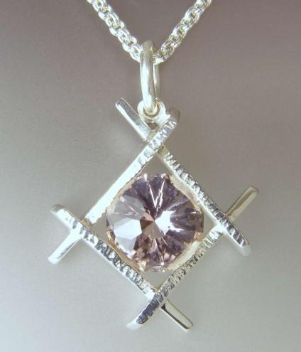 Morganite pendant in silver - 5.40ct round morganite fancy cut, set in rough hewn silver frame