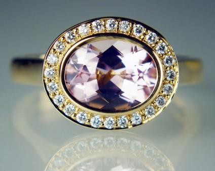 Morganite & diamond halo ring in 18ct rose gold - 1.54ct oval cut morganite set with 0.15ct round brilliant cut diamonds G colour VS clarity in 18ct rose gold ring