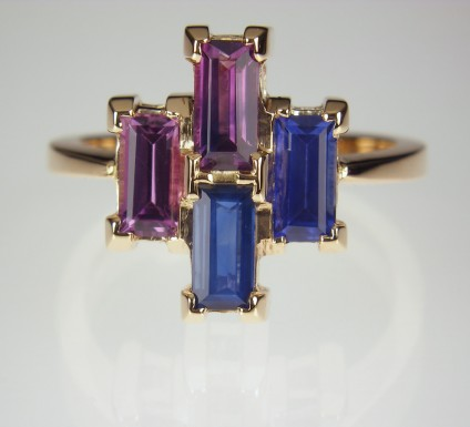 Sapphire ring in Rose Gold - Baguette cut sapphires in shades of blue and pink set in 18ct rose gold.