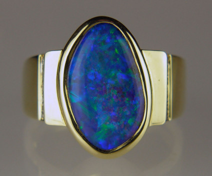 Boulder opal & diamond ring in 18ct yellow gold - 4.97ct boulder opal from Queensland set with 2 points of diamond in 18ct yellow gold ring