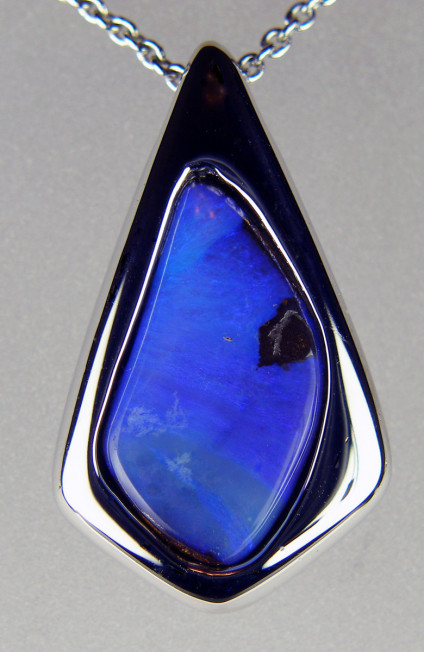 Boulder opal pendant in silver - Vivid blue boulder opal in silver. Pendant is 28 x 18mm. Boulder opal is from Queensland, Australia.