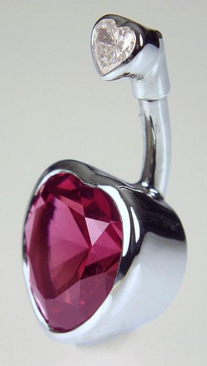 Garnet & diamond navel jewel in gold - Navel Jewel. Navel jewel of 3.53ct rhodolite garnet set with 0.13ct heart shaped diamond in 18 carat white gold. 25 x 12mm.