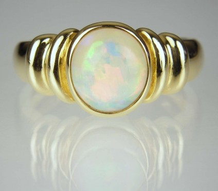 Opal Ring - Opal round cabochon ring in 18ct yellow gold