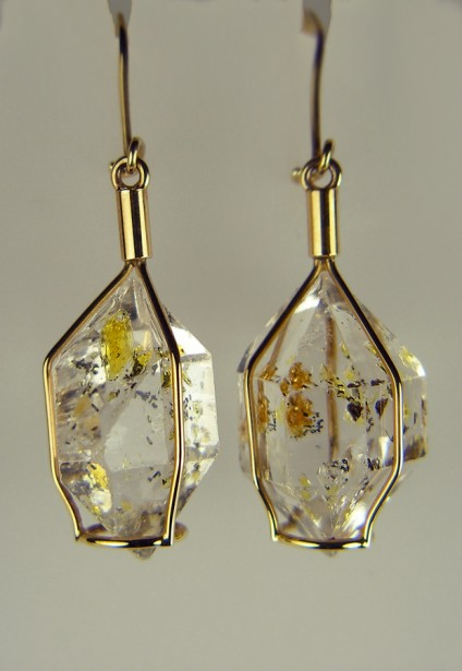 Oil included quartz earrings - Oil included quartz earrings in 9ct yellow gold. Beautiful drop earrings made from rare hydrocarbon included natural quartz crystals from Baluchistan.  Comes with an ultraviolet pen torch to illustrate the light oil fluorescence.  Earrings drop 47mm, crystal width 17mm.