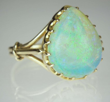 Opal cabochon ring - Estate piece set with large pear shaped cabochon opal in vivid turquoise blues, mounted in 9ct yellow gold