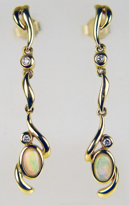 opal & diamond earrings in 18ct yellow gold - Delicate drop earrings with oval white solid opals set with 4 x 1.5mm diamonds mounted in 18ct yellow gold. Earrings are 35mm long.
