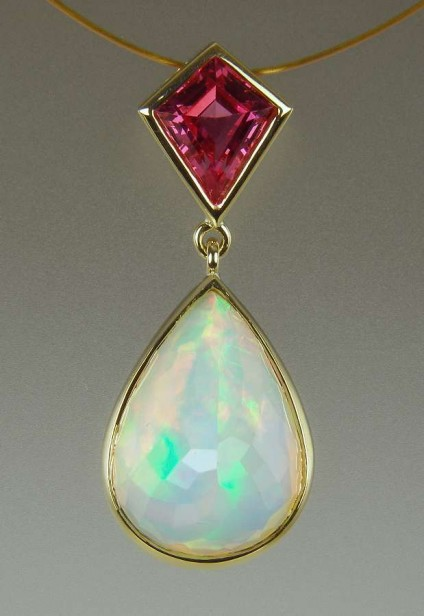 Opal & Spinel Pendant - Vivid coloured faceted pear cut solid Ethiopian opal set with a kite cut spinel from Mahenge, Tanzania, in 18ct yellow gold