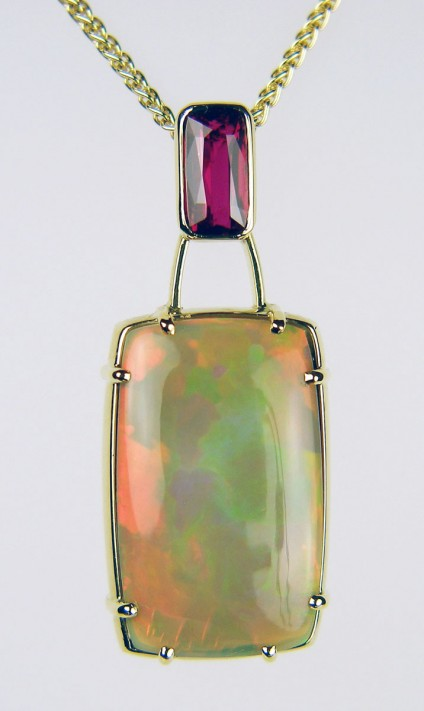 Ruby & opal pendant - 2.05ct cushion cut ruby, with independent certification confirming natural colour and origin, set with 17.99ct rectangular cushion cut cabochon Ethiopian opal in 18ct yellow gold