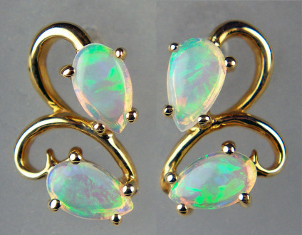 Opal earstuds in 9ct yellow gold - 0.60ct of beautiful white opal pear cut cabochons in 9ct yellow gold earstuds. Earstuds are 11x8mm.