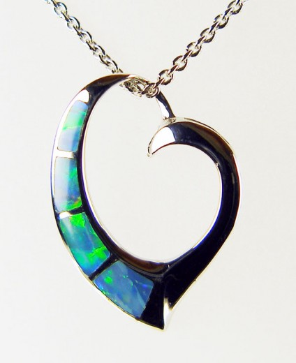 "Silver heart pendant inlaid with black opal - Pretty silver pendant inlaid with Australian solid black opal. The pendant has been rhodium plated to resist tarnishing and is suspended from a rhodium plated silver chain of adjustable length 15-22""."