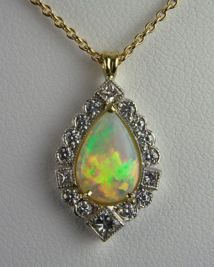 Opal & diamond pendant - Pear cut opal 1.13ct set with 0.38ct diamonds in 18ct white & yellow gold