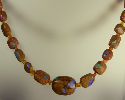 Opalised wood in sandstone necklace - Very rare opalised wood in sandstone bead necklace with 9ct yellow gold clasp. Necklace is 49cm long.