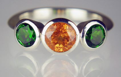 Chrome diopside & mandarin garnet ring in silver - 1.28ct round brilliant cut spessartine (mandarin) garnet set with a 1.22ct matched pair of round cut green chrome diopside set in a handmade silver ring.