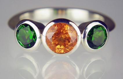 Chrome diopside & mandarin garnet ring in silver - 1.28ct round brilliant cut spessartine (mandarin) garnet set with a 1.22ct matched pair of round cut green chrome diopside set in a handmade silver ring.