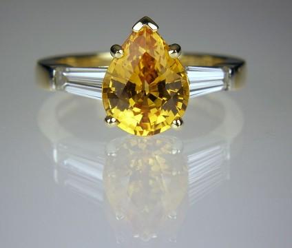 Sapphire & diamond ring in platinum - Intense golden orange Madagascan sapphire & diamond ring in 18ct gold & platinum.